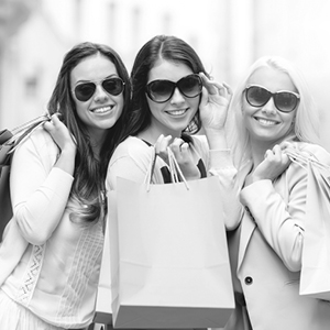 three women in sunglasses smiling