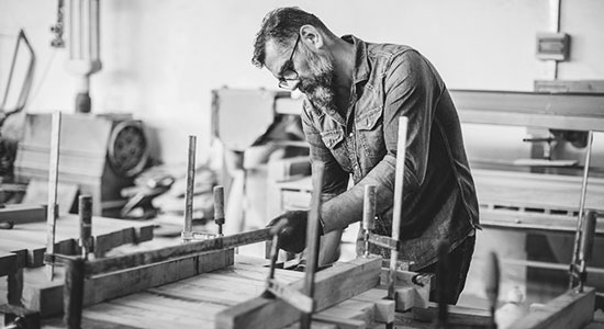 Older man working in a woodshop
